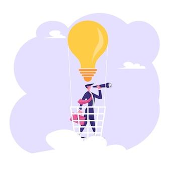 電球の気球の手スタンドにブリーフケースを持つビジネスマン