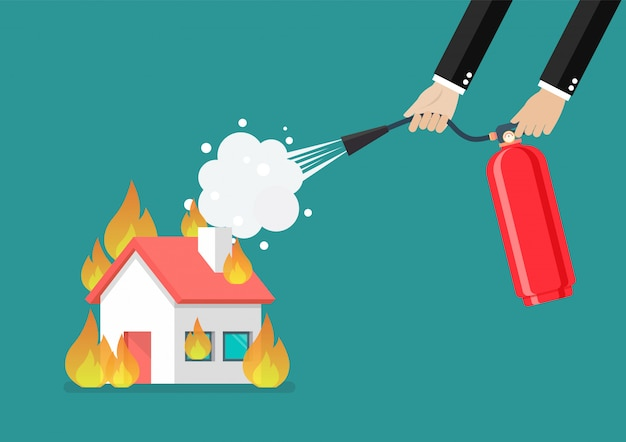 Businessman with fire extinguisher is fighting with the burning house