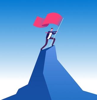 山のピークに旗を持ったビジネスマン