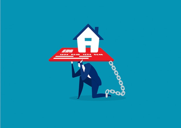 Businessman with foot chained to home credit card debt concept