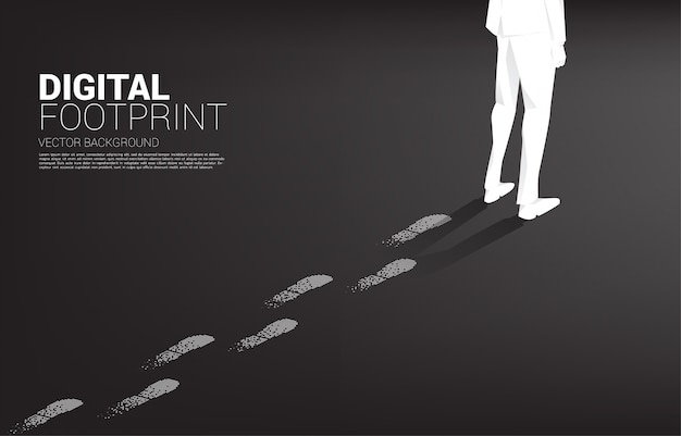 Бизнесмен с след от след от цифровой точки пикселей. бизнес-концепция цифрового преобразования и цифровой след.