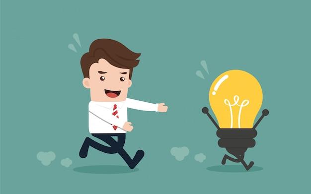 Businessman with idea light bulb.
