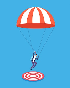 Businessman with parachute aiming on target.