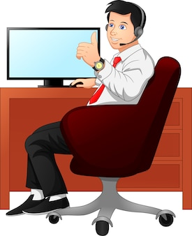 Businessman at work desk showing thumbs up