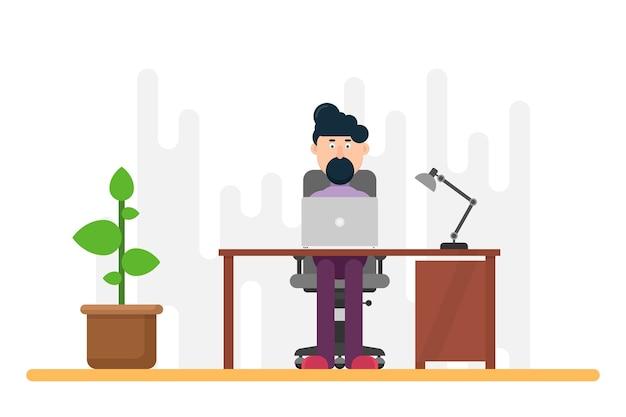 Бизнесмен, работающий за столом