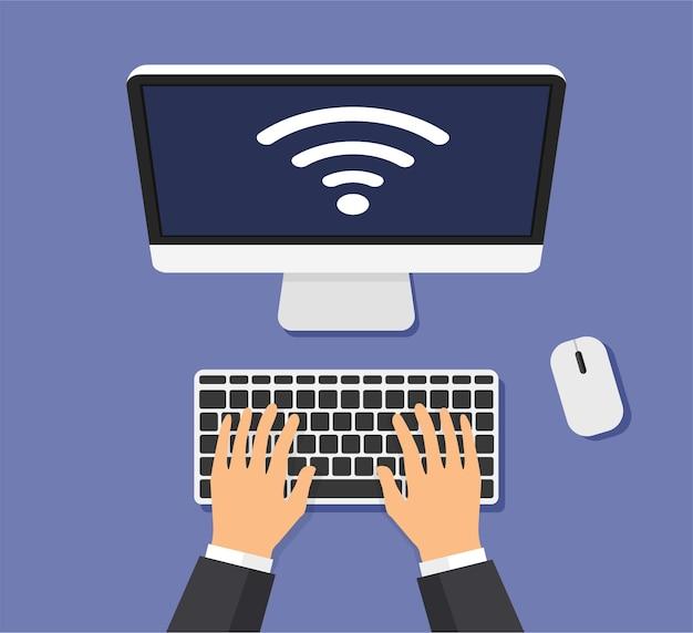 ビジネスマンはコンピューターで働いています。 wi-fiは画面に信号を送ります。インターネットの概念。俯瞰図。
