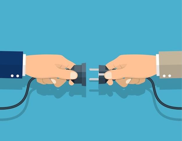 홀드 플러그와 콘센트를 손에 연결하는 기업인, 협력, 파트너십 개념