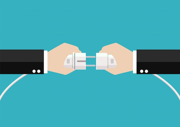 Businessmen hands are connecting plug and outlet
