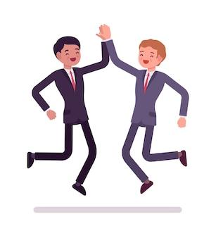 Businessmen high five jumping