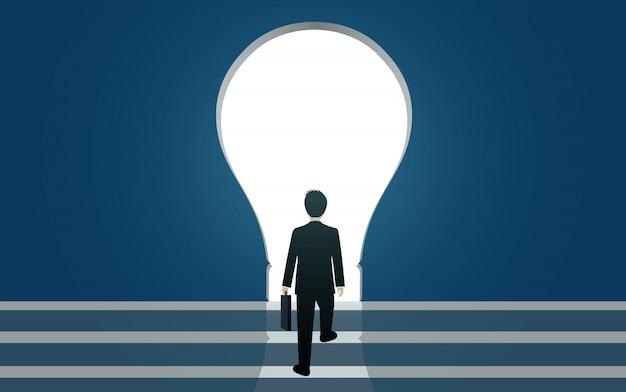 ビジネスマンは電球の隙間に歩きます