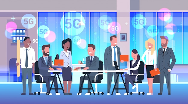 Businesspeople brainstorming during conference meeting 5g online wireless system connection mix race business people working together modern office interior horizontal full length