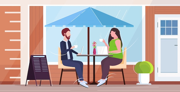Businesspeople couple discussing during meeting business people man woman sitting at table drinking coffee communication concept modern street cafe exterior  full length horizontal
