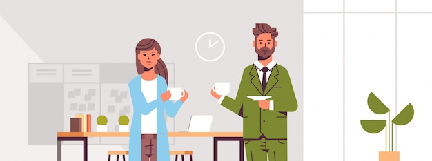 Businesspeople couple drinking cappuccino business man woman discussing during meeting coffee break modern office interior lounge area