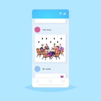 Businesspeople group having meeting sitting at round table colleagues brainstorming successful teamwork concept smartphone screen mobile app  full length