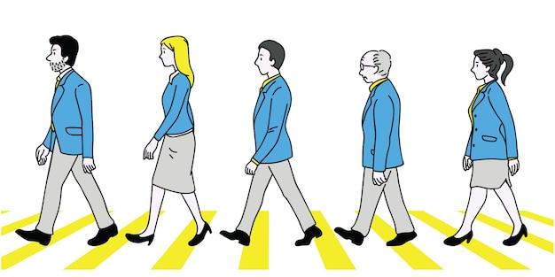 얼룩말 교차점을 산책하는 비즈니스맨