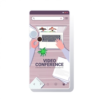 Businessperson chatting with mix race colleagues during video call business people having online conference meeting communication concept smartphone screen copy space illustration