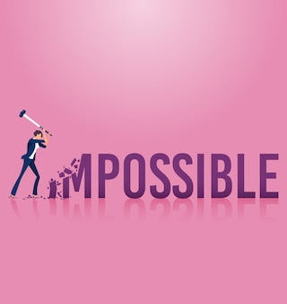 Businesswoman destroying the word impossible to possible