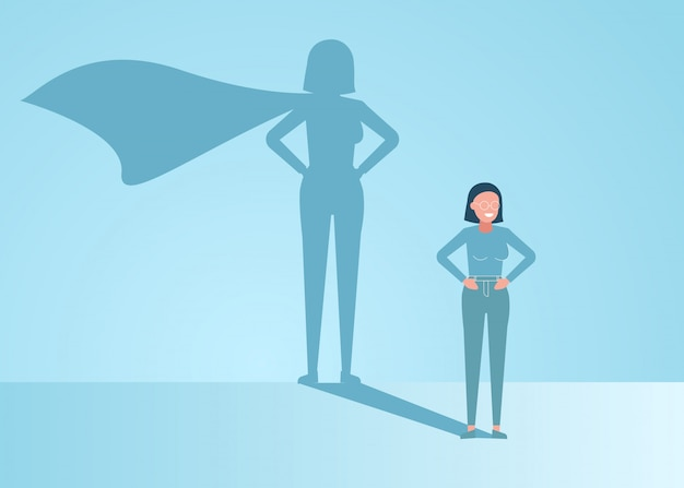 Businesswoman dreams of becoming a superhero. confident handsome young businessman standing superhero shadow concept illustration