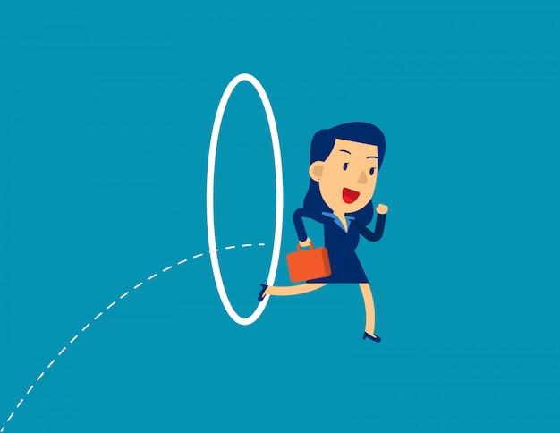 Businesswoman jumping through hoop.