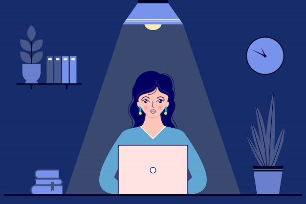 Businesswoman in office at night