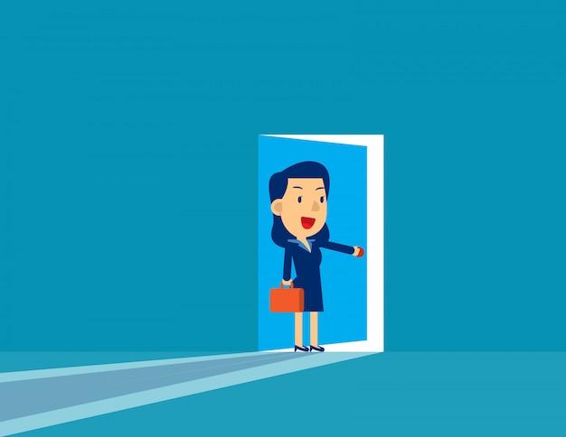 Businesswoman opening door.