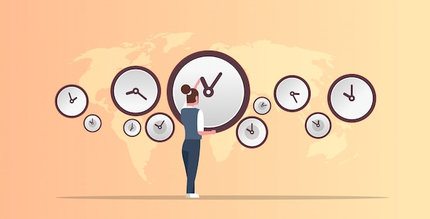 Businesswoman pointing on wall with clocks different cities time management deadline concept world map background horizontal full length