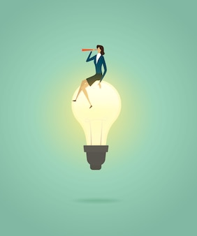 Businesswoman sit on lightbulb creative concept solution and with telescope see vision