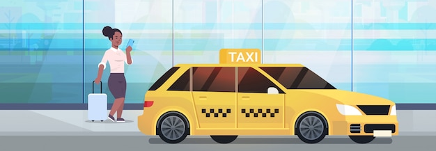 Businesswoman using mobile app ordering taxi on street   business woman in formal wear with luggage near yellow cab city transportation service concept full length horizontal