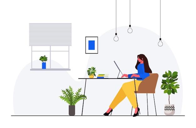 職場のモダンなオフィスのインテリアに座っているコンピュータービジネスの女性に取り組んでいる実業家