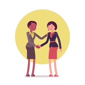 Businesswomen greeting handshaking