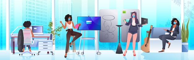 Businesswomen in masks working and talking together in coworking center coronavirus pandemic teamwork concept modern office interior horizontal full length