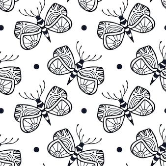 Butterflies seamless pattern in ornamental hand drawn style. block print textile design with cute black and white butterfly.