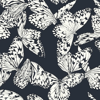 Butterfly seamless pattern in black and white on deep blue
