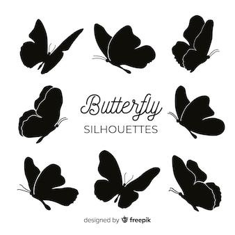 Бабочка летает силуэты