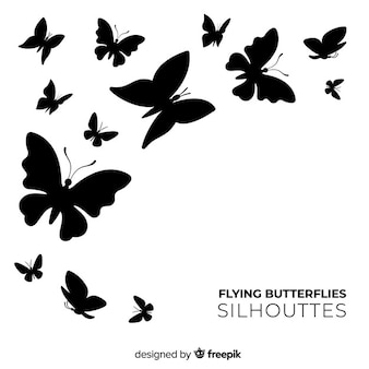Butterfly silhouettes swarm background