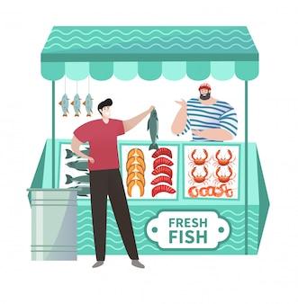 Покупатель в магазине рыб свежего океана покупая натуральные продукты океана свежести в fishmarket изолированном на белизне.