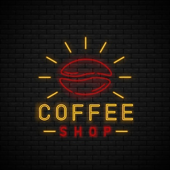 Неоновая вывеска кафа на кирпичной стене. перерыв на кофе
