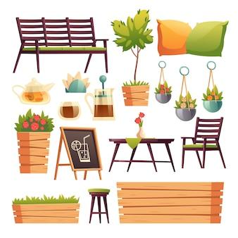 木製のバーカウンター、座席、花や植物のあるカフェやレストランのテラス