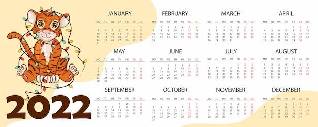 虎のイラストが描かれた、中国または東部の暦による虎の年である2022年のカレンダーデザインテンプレート。 2022年のカレンダーと水平テーブル。ベクトル