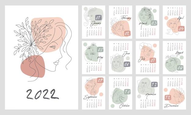 2022년 달력 템플릿입니다. 추상적인 여성의 얼굴을 가진 수직 디자인입니다. 편집 가능한 벡터 삽화, 모자가 있는 12개월 세트. 한 주가 월요일에 시작됩니다.