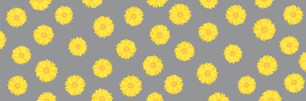 究極の灰色の背景に今年の黄色のパントン色を照らすカレンデュラまたはマリーゴールドの花のパターン