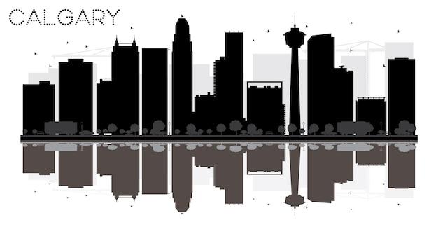 Город калгари на фоне линии горизонта черно-белый силуэт с отражениями. векторная иллюстрация. простая плоская концепция для туристической презентации, баннера, плаката или сети. городской пейзаж с известными достопримечательностями