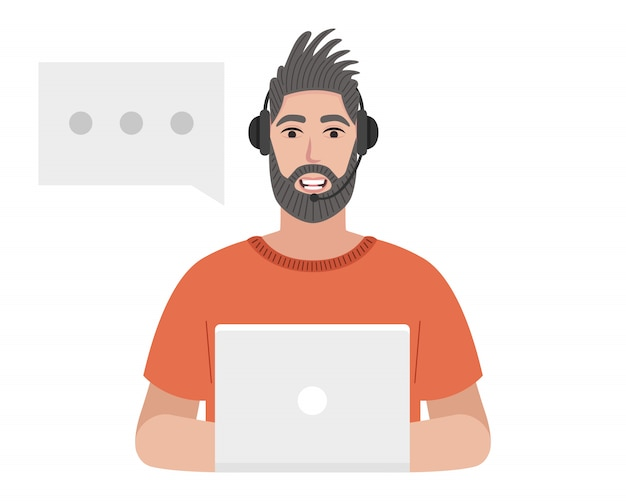 Call center operator with a headset is typing on the laptop. bearded man talking