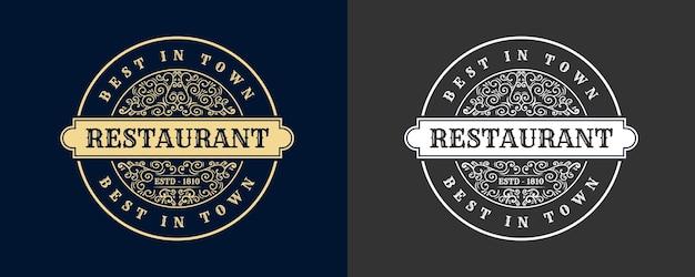 書道のフェミニンな花の美しさのロゴ手描きの紋章モノグラムアンティークビンテージスタイルの豪華なデザインのホテルのレストラン