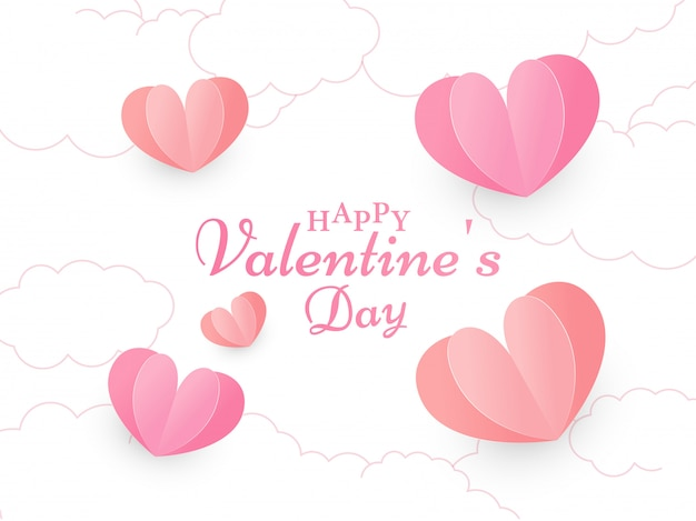 Calligraphy happy valentine's day text on white cloud  decorated with red and pink paper cut hearts.