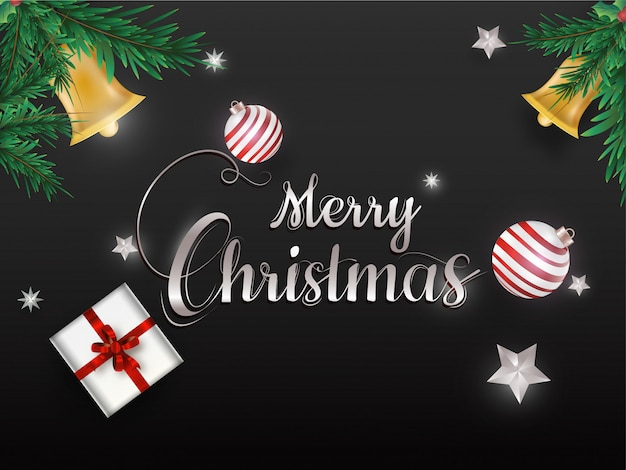 Calligraphy of merry christmas decorated with baubles, stars, gift box, jingle bell and pine leaves on black .