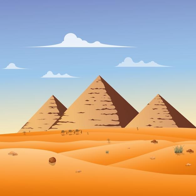 야생 기자의 피라미드 풍경 배경에서 낙 타 카라반