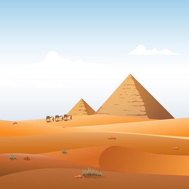 이집트 피라미드 풍경 배경으로 낙 타 카라반