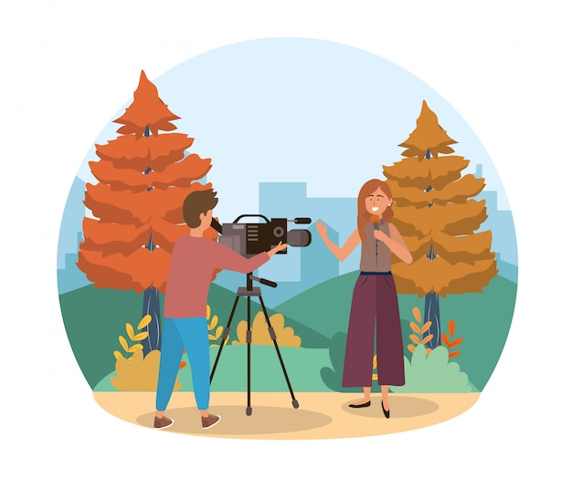 Camera man with camcorder and woman reporter with microphone