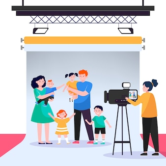 スタジオで大家族のシーンを撮影するカメラマン